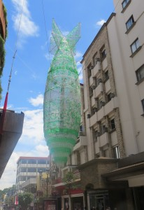 Hanging sculpture downtown made of plastic bottles promoting recycling