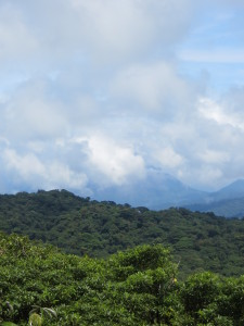 Arenal Volcano in the distance behind the clouds on the left-hand side.